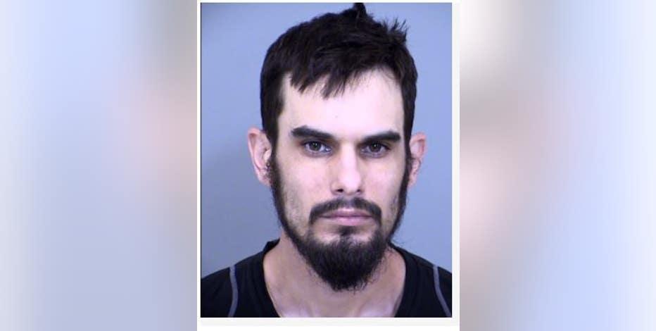 Man arrested in road rage shooting near Loop 101 and Hayden