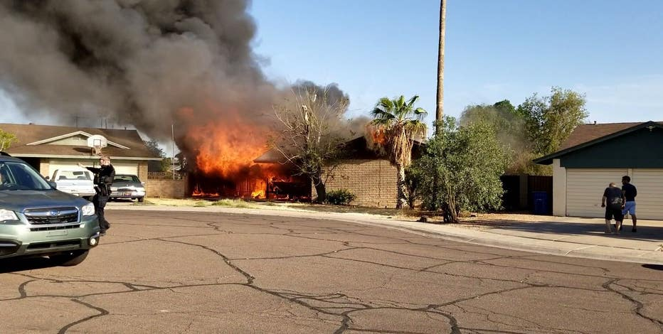 Neighbor and his friends rescue man, his dog from burning Tempe home