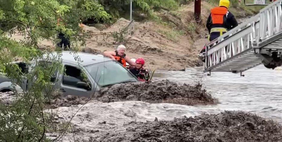 Crews rescue 3 from vehicle in runoff-swollen Tucson wash