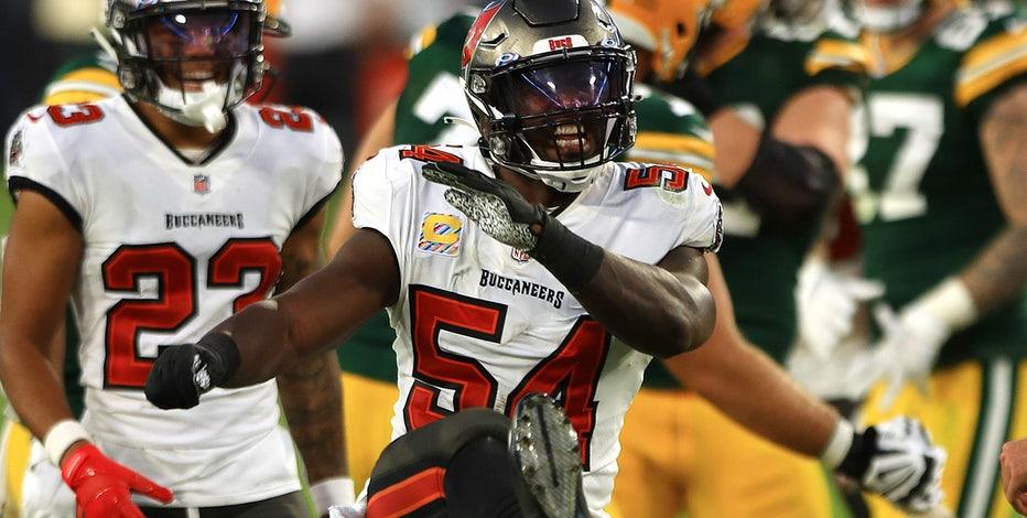 Dominating defense helps Brady, Buccaneers top Packers