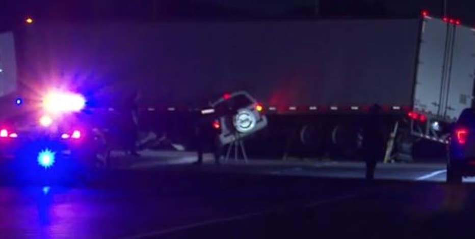 Driver, passenger trapped inside SUV after crashing into 18-wheeler in Baytown