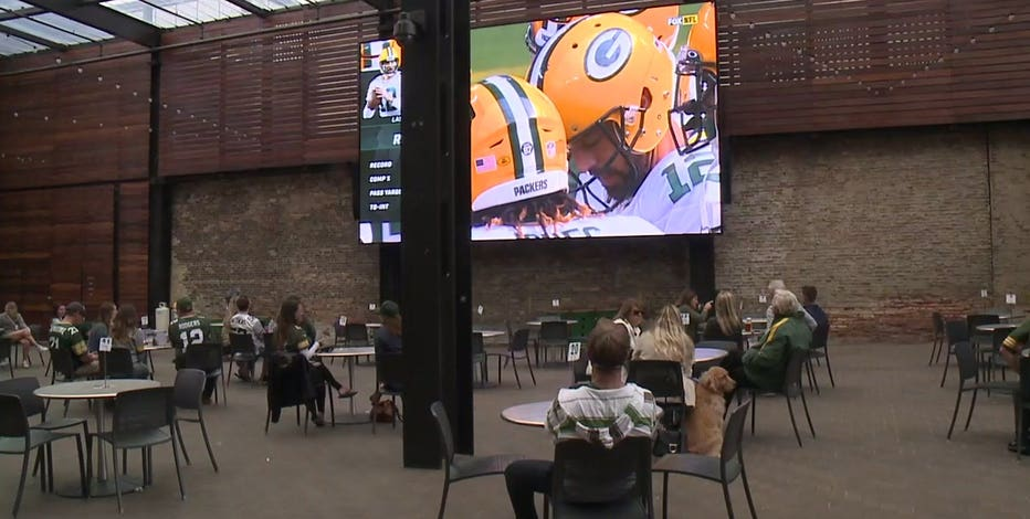 Packers fans, 'happy there's a season,' watch game at 'distanced tables'