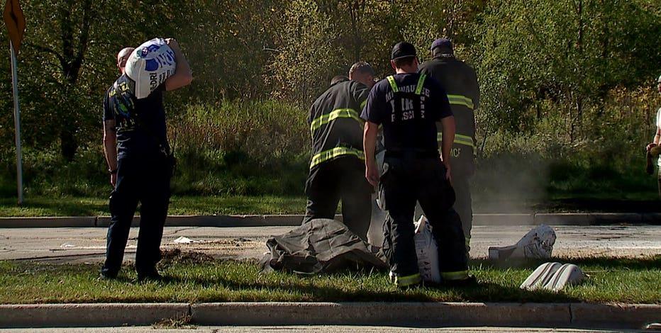 Car runs red light, hits van hauling tar, spills on roadway