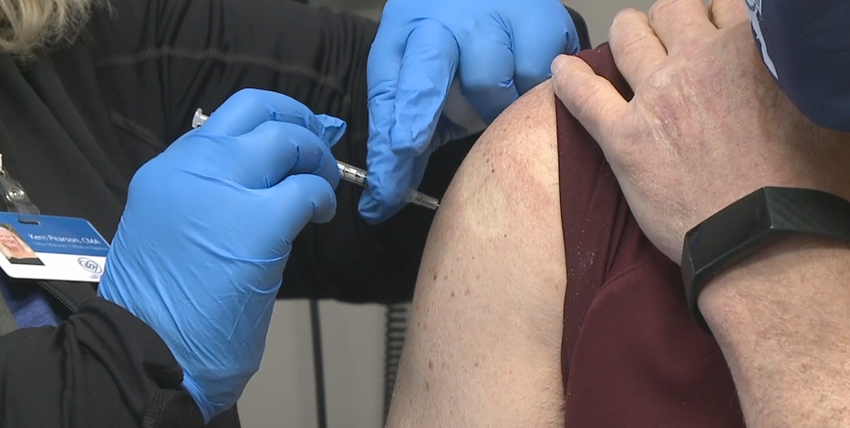 Masks, distancing still crucial as vaccines roll out, doctors say