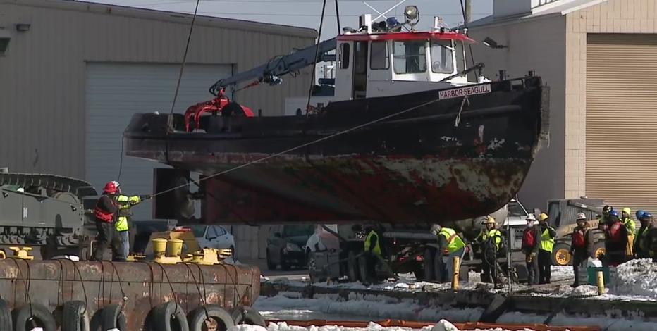 Crews retrieve Port workboat Harbor Seagull from river bottom