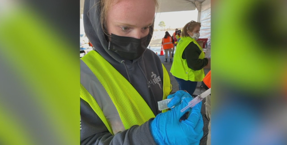 Meet the people behind the masks at vaccine site in Milwaukee