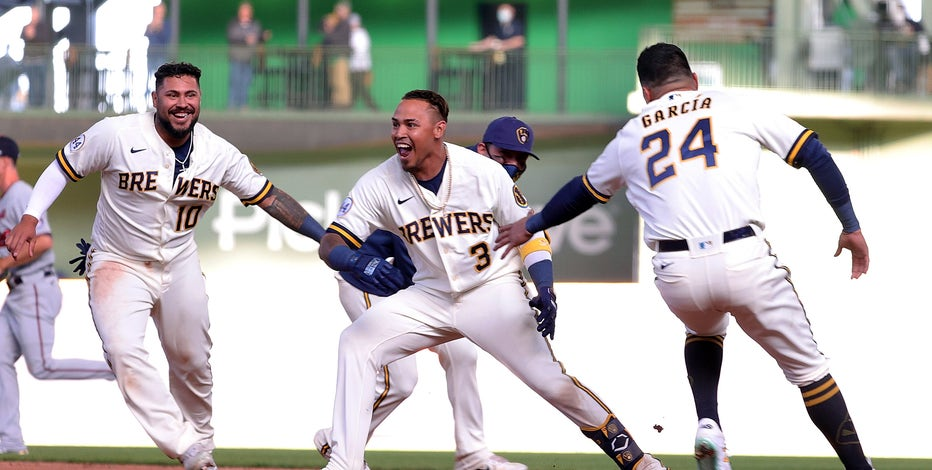 Brewers rally in 9th, win it in 10th to top Twins in home opener