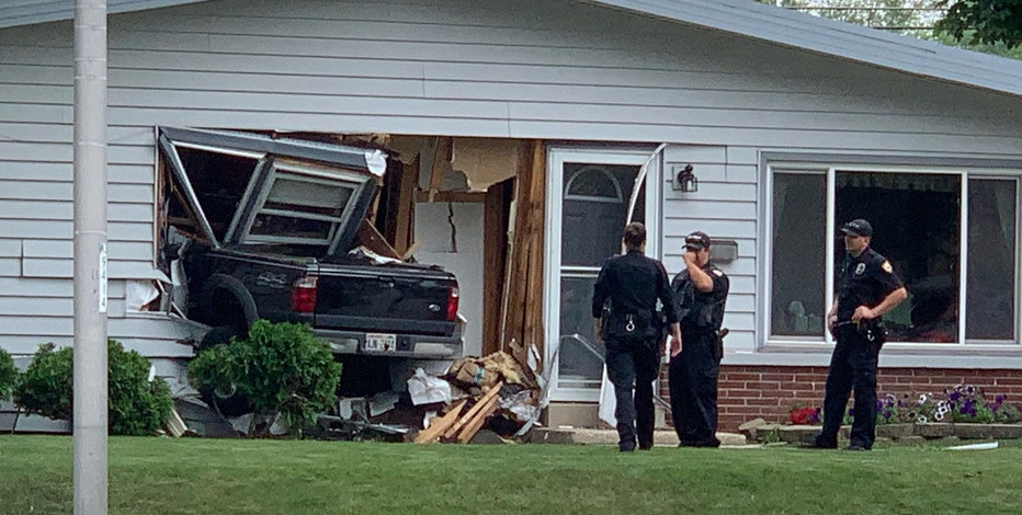 Truck crashes into West Allis home, driver suspected of OWI