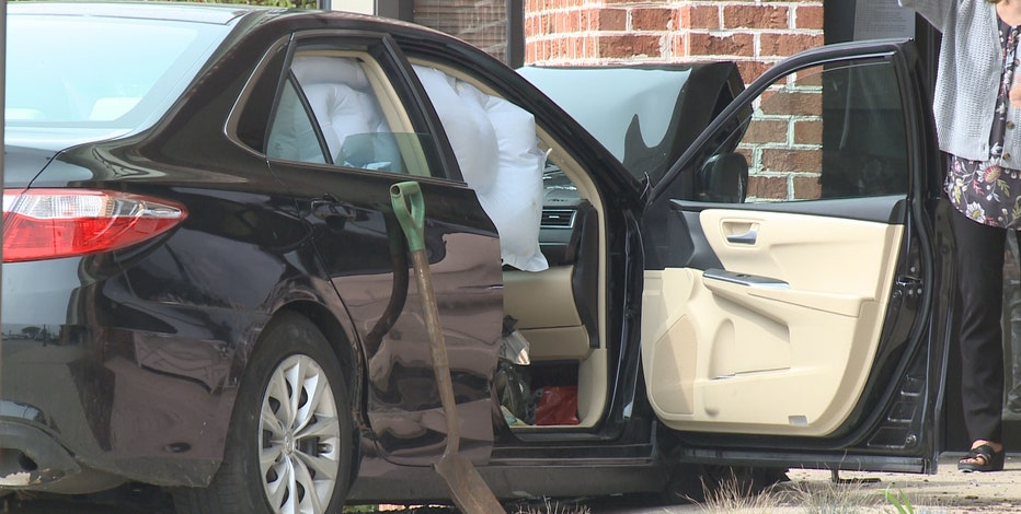 Mequon car crash into building; driver injured, cited