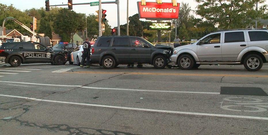 Milwaukee police car hit near Teutonia and Villard
