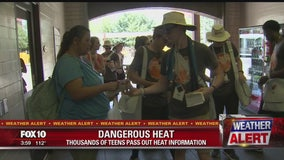 Teens in the Valley for church youth conference helping others beat the Valley heat