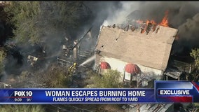 Woman escapes house fire in Cave Creek that spread to yard and brush