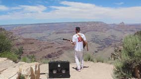 Guitar player plays 'The Star-Spangled Banner' in the Grand Canyon