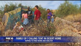 HARD TIMES: Family of seven calls a tent in the desert home