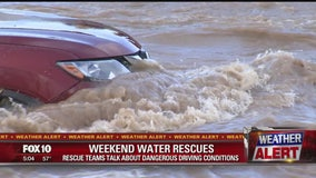 Father and son rescued from raging wash waters