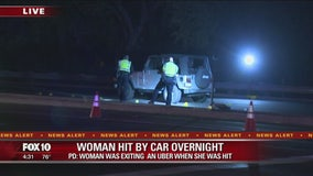Police: Woman hit by car after getting out of Uber