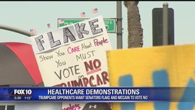 Demonstrators protest outside McCain and Flake's offices before vote on AHCA bill