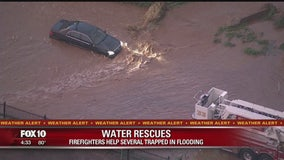 Crews rescue drivers in Sunnyslope neighborhood due to flooding