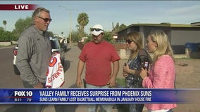 Suns surprise Valley family who lost basketball memorabilia in house fire