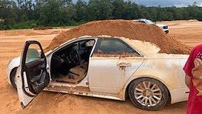 Florida man arrested for using front-end loader to dump dirt on girlfriend's car