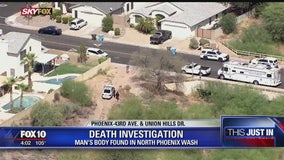 Police: Workers find dead body in north Phoenix wash