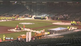 Volunteers transforming Chase Field into convention hall