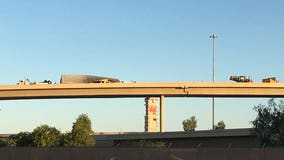 Semi-truck carrying produce flips on its side along I-10 ramp