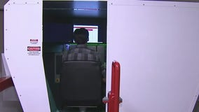 Redbird simulator teaches high school students to fly