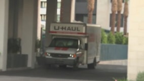 Apartment residents evacuated after U-Haul crashes into parking garage, strikes water and gas lines