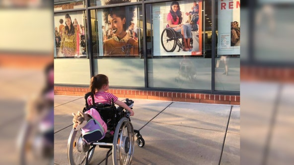 Little girl with rare disease captivated by beauty ad of woman in wheelchair