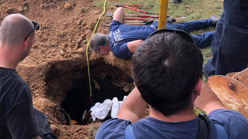 Woman rescued after falling into septic tank, laying in raw sewage for days, officials say