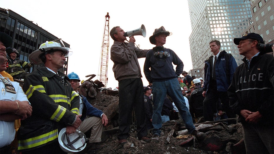 President George W Bush rallies firefighters and rescue workers during an impromptu speech at the site of the collapsed World Trade Center.