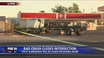 South Phoenix intersection closed after car crashes into semi, causing fuel spill