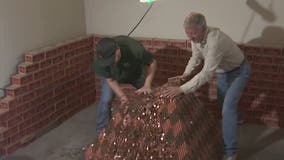 Valley man cashes in more than 1 million pennies that were used to build giant pyramid
