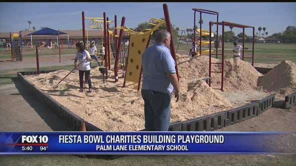 Fiesta Bowl Charities build playground at Palm Lane Elementary