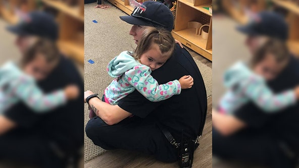 Viral photo shows firefighter comforting preschooler recently diagnosed with autism