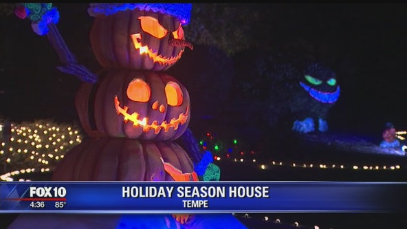 Tempe homeowners celebrate the holiday season by decorating for Halloween and Christmas at once