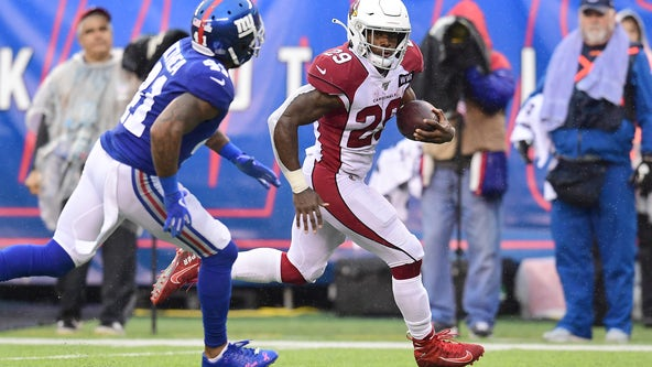 Edmonds runs for 3 TDs, Cards top Giants in Barkley's return
