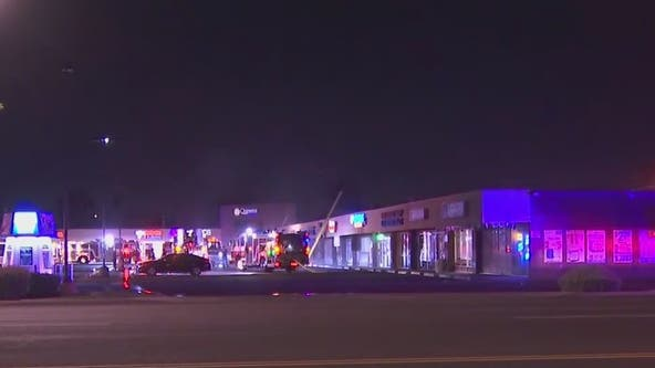 Firefighters battle 1st-alarm fire at west Phoenix strip mall