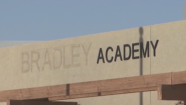 a sign for the now-shuttered Bradley Academy in Goodyear, Arizona