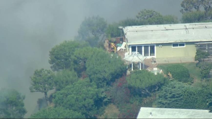 Brush fire burning uphill in Pacific Palisades