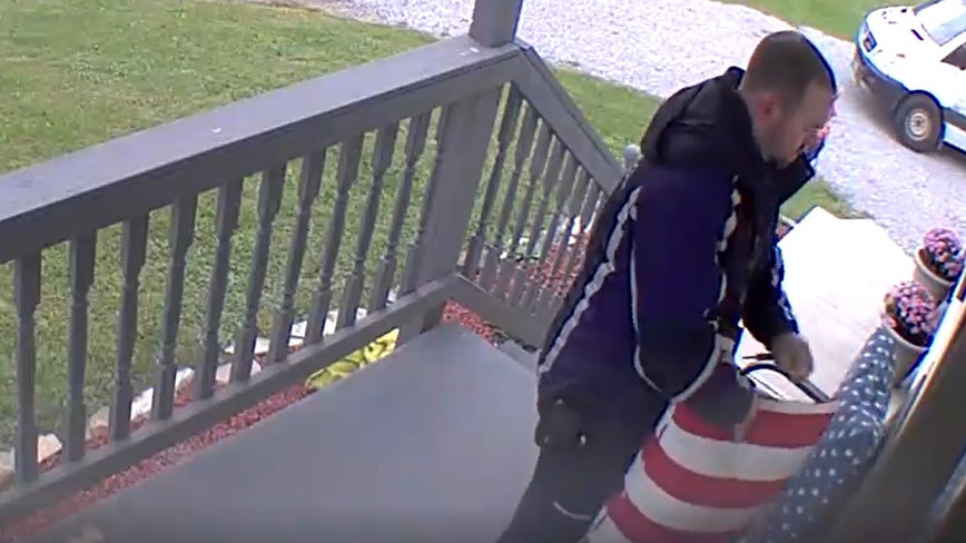 FedEx man fixes stars and stripes during delivery