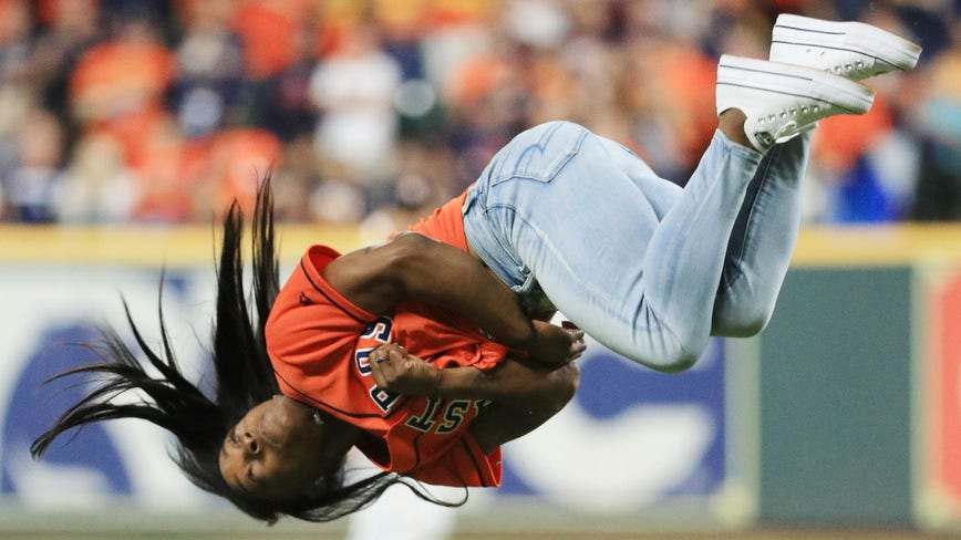Simone Biles throws first pitch in Game 2 of the World Series, with a twist
