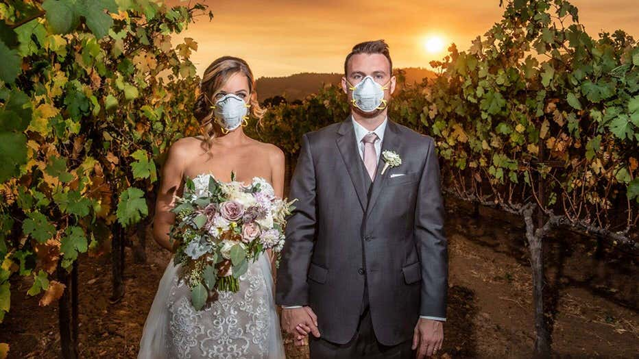 Couple Poses For Wildfire Wedding Photo During Smoky Ceremony At