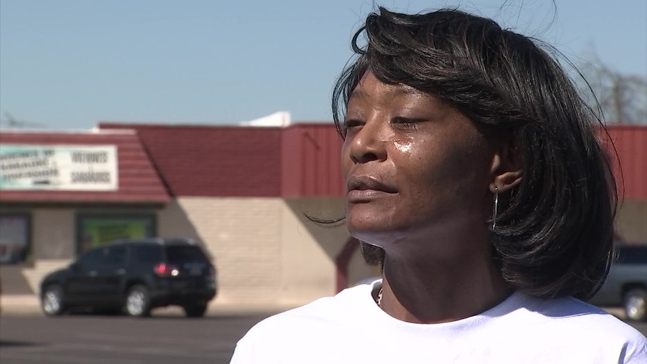 A photo of Courtney Brown, wearing a white shirt. Her husband died while in Phoenix Police custody.