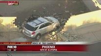 SUV crashes through fence, into backyard of Phoenix home