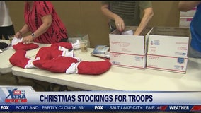 Volunteers stuff stockings for troops overseas