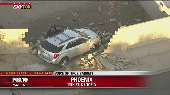 SUV crashes through fence, into backyard of Phoenix home
