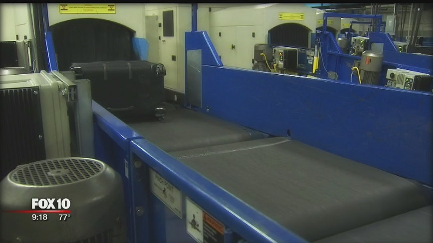 Behind the scenes of screening checked luggage at Sky Harbor