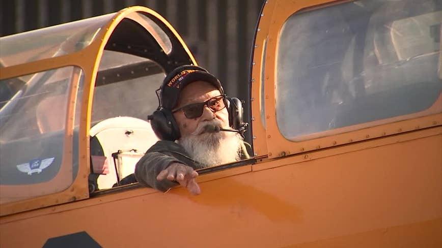Veteran flies in World War II-era aircraft in surprise for 100th birthday